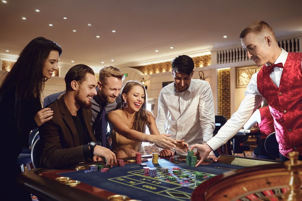 A happy woman takes a win at the roulette poker casino